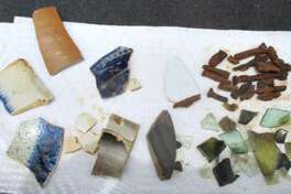 Ceramic sherds, pieces of glass and nail remnants associated with the Farmer's Hotel investigation (June 2014).