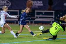 Freshman Heather Plowright scores the only goal in Wilton's 1-0 state tournament win over Fairfield Warde.