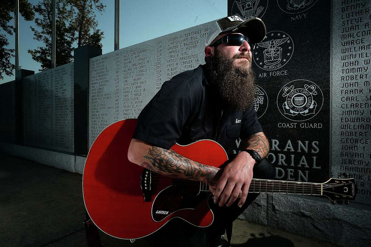 """Musician Lee Pelly created the foundation """"No Stone Left Unturned"""" to help raise money to place military markers on veterans' gravesides after learning that there were several in local cemeteries that have gone unmarked. The organization raises money to cover the cost of providing the markers largely through music shows, and will hold their next fundraising concert, called Hellcat Hoedown, October 3. Among the cemeteries the foundation has completed providing veteran headstones is Forest Lawn Cemetery, at which stands a large monument - the Veterans Memorial Wall and Gardens - in tribute to area veterans. Photo taken Tuesday, September 22, 2015 Photo by Kim Brent"""