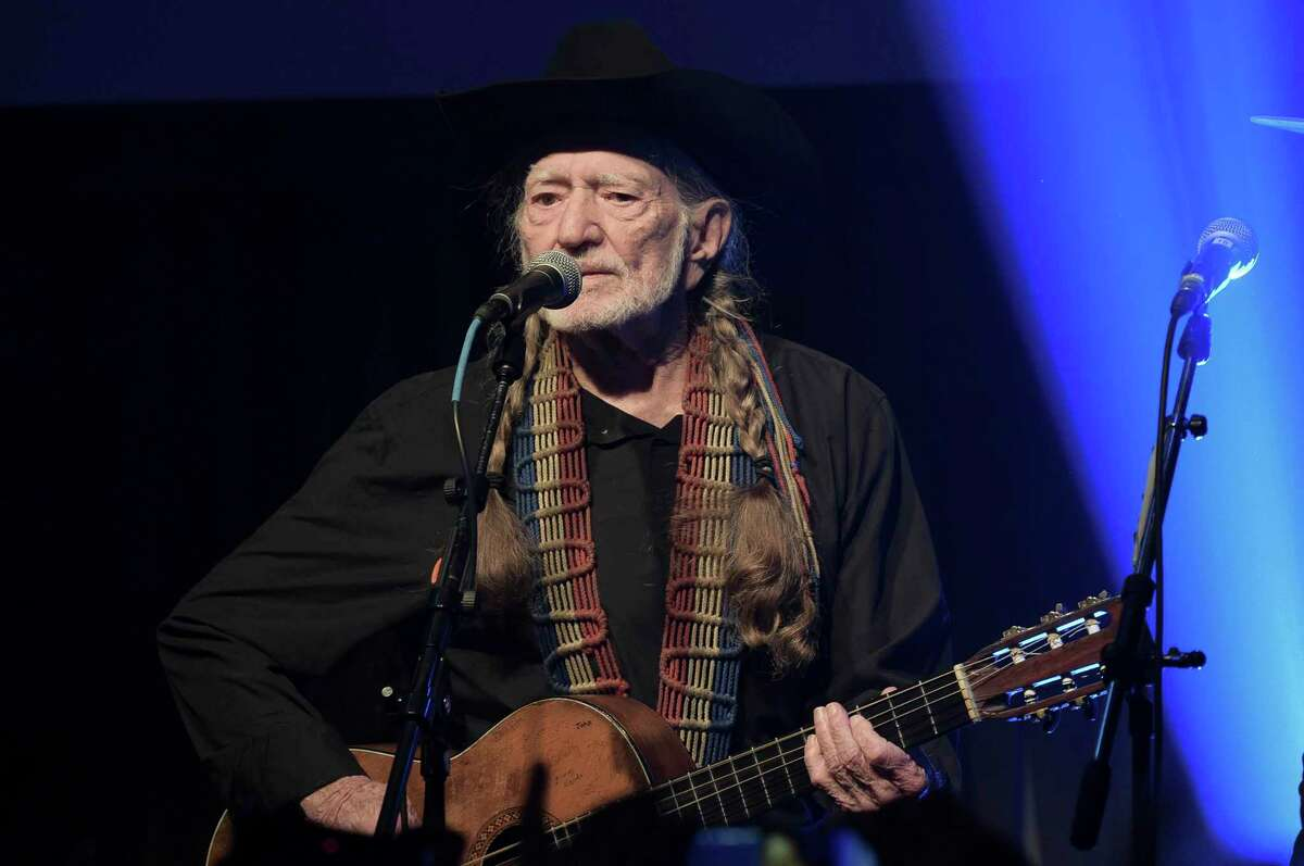 """FILE - In this Feb. 6, 2019 file photo, Willie Nelson performs at the Producers & Engineers Wing 12th Annual GRAMMY Week Celebration at the Village Studio in Los Angeles. Nelson has canceled his tour because of a """"breathing problem."""" The 86-year-old singer apologized on Twitter late Wednesday, Aug. 7, writing """"I need to have my doctor check out."""" Nelson had just finished performing with Alison Krauss in Toledo, Ohio, and he was next scheduled to appear Friday in Grand Rapids, Mich. He wrote """"I'll be back.""""(Photo by Richard Shotwell/Invision/AP, File)"""