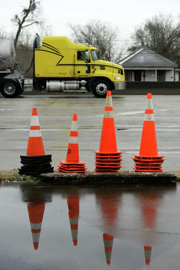 Cones, used for shutting down access to I-10 westbound, sit by the side of the road before the highway was shut down Tuesday. More freezing weather moved into southeast Texas on Tuesday morning. The cold snap is expected to last into Wednesday. Photo taken Tuesday, 1/28/14 Jake Daniels/@JakeD_in_SETX Photo: Jake Daniels / Jake Daniels/ / ©2013 The Beaumont Enterprise/Jake Daniels