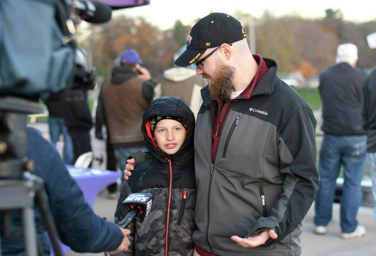 Billy Sperbeck age 11 years of Voorheesville, left, and his Big Brother, Jay Stokes of Guilderland, talk with a television reporter during a capital region Big Brothers-Big Sisters event while watching an NCAA football game between Maine and University at Albany Saturday, Nov. 2, 2019, in Albany, N.Y.