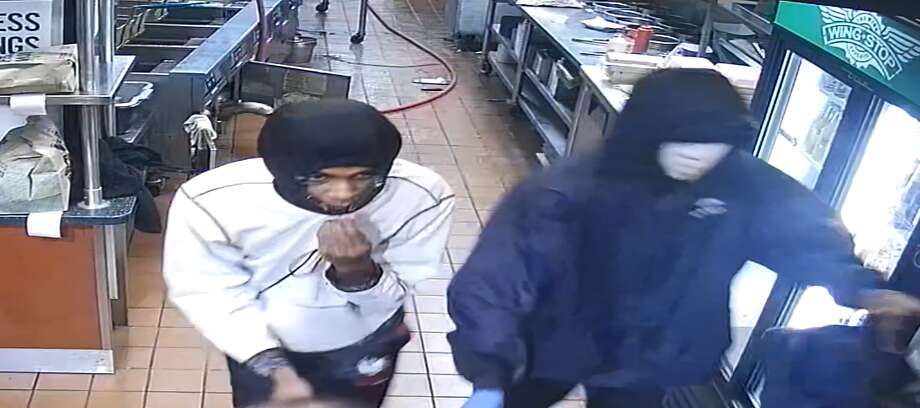 Crime Stoppers if offering a reward for two suspects accused of an armed robbery at a Northeast Side Wing Stop. Photo: Crime Stoppers