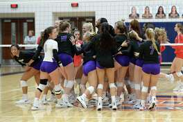 The Fulshear Chargers celebrate their 3-0 victory over the Bellville Brahamanettes in a Class 4A Region IV Quarterfinal volleyball playoff match on Tuesday, November 12, 2019 at Bridgeland HS, Cypress, TX.