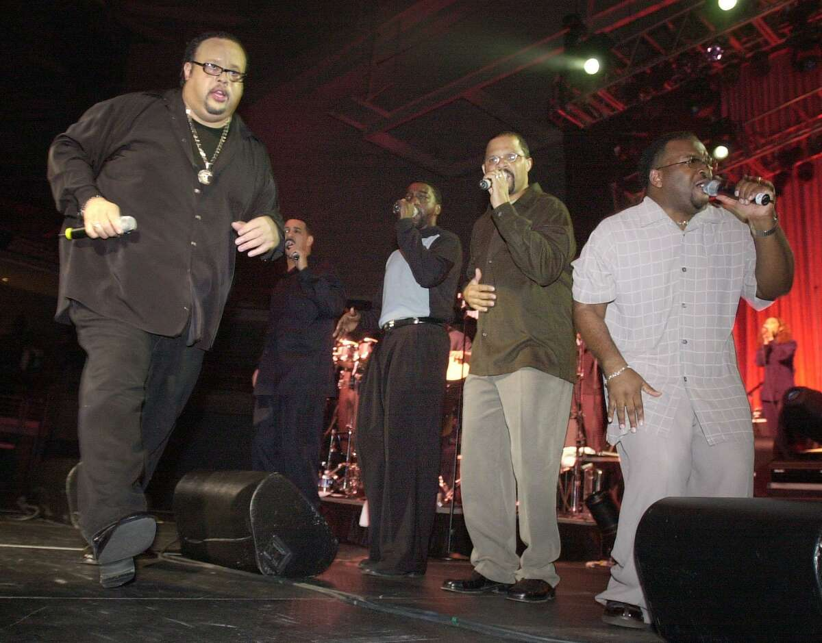 Members of the gospel group Commissioned, from left, Fred Hammond, Karl Reid, Mitchell Jones, Keith Staten, and Marcus Cole perform as part of a previous reuntion tour in 2002.