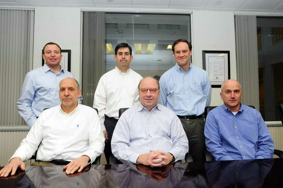 Several of private equity firm Olympus Partners' partners gather in the firm's Station Place offices in Stamford, Conn., on Dec. 19, 2017. From left, are: partner Jason Miller, managing partner Lou Mischianti, partner Evan Eason, founder and managing partner Rob Morris, partner David Haddad and partner Paul Rubin. Photo: Michael Cummo / Hearst Connecticut Media / Stamford Advocate