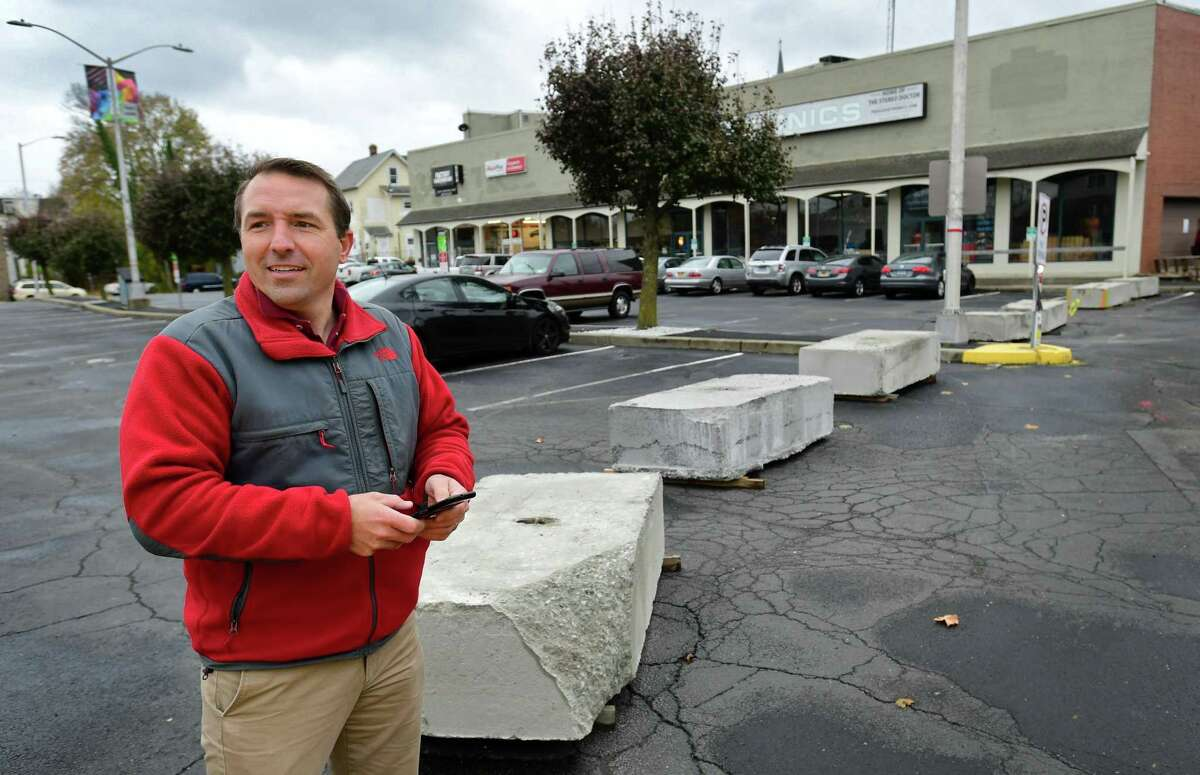 Concrete barriers block access to the parking lot Developer Jason Milligan owns on Isaac Street in Norwalk, blocking the ability for cars to drive through the lot from Wall Street to Leonard Street. Instead, drivers coming down Isaacs will be forced to turn around and exit back to Wall Street, going the wrong way down a previously posted one-way street.