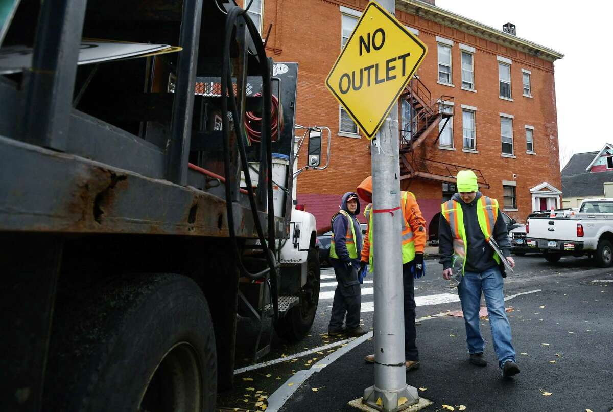 Norwalk Department of Public Works put up No Outlet signs at the end of Isaac Street after barriers were pu up blocking access to the parking lot Developer Jason Milligan owns on Isaac St. Tuesday, November 12, 2019, blocking the ability for cars to drive through the lot from Wall St to Leonard St. in Norwalk, Conn. Instead, drivers coming down Isaacs, will be forced to turn around and exit back to Wall St going the wrong way down a previously posted one-way street.