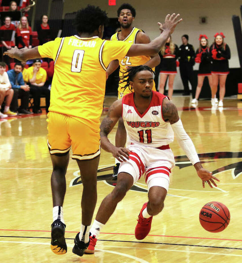SIUE's Tyreese Williford (11) changes course while Valpo's Javon Freeman-Liberty defends the break on Tuesday at First Community Arena in Edwardsville. Photo: Greg Shashack | Hearst Illinois
