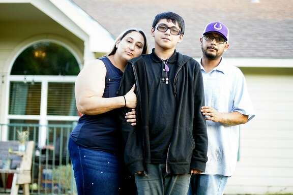 Xavier Castro outside his home with his parents in Dayton. After receiving free help from lawyers, Xavier now has special education services.