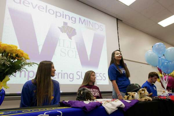 Willis softball player Madison Matranga acknowledges her parents during a National Signing Day ceremony at Willis High School, Wednesday, Nov. 13, 2019, in Willis. Matranga signed to play softball for Odessa College, while teamamtes Ashley Vallejo and Hannah Earls signed with McNeese State and Texas State. Baseball player Mason Creacy signed to play baseball for Murray State.