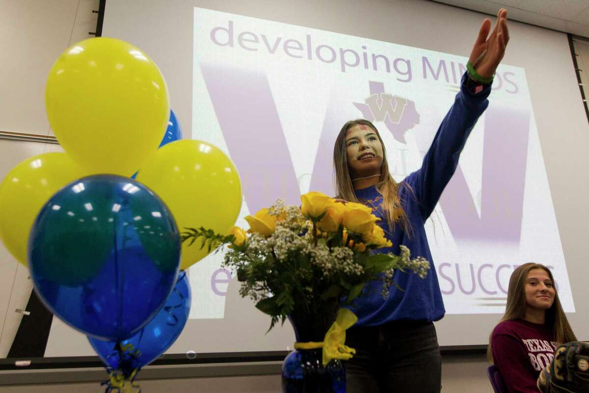 Willis softball player Ashley Vallejo acknowledges her parents during a National Signing Day ceremony at Willis High School, Wednesday, Nov. 13, 2019, in Willis. Vallejo signed to play softball for McNeese State, while teammates Hannah Earls and Madison Matranga signed with Texas State and Odessa College. Baseball player Mason Creacy signed to play baseball for Murray State.
