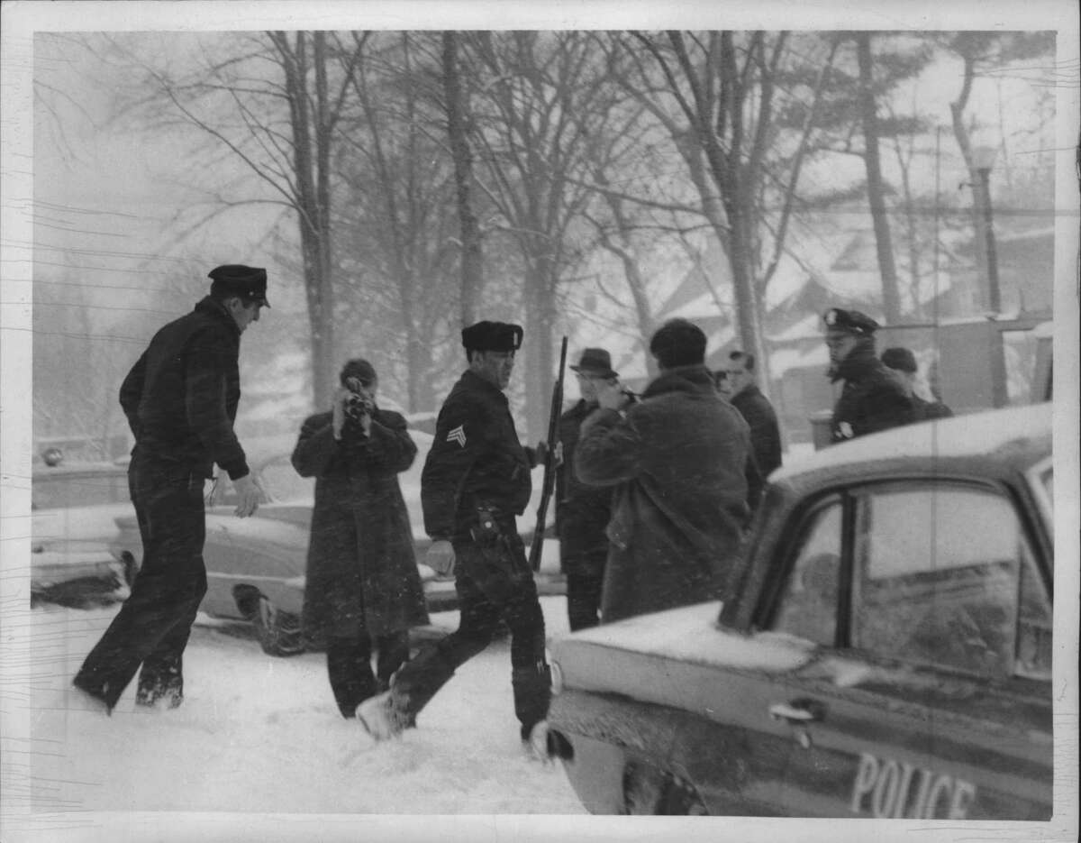 Officials outside the Manning Boulevard home where Albany Sgt. Thomas McAvoy was shot in 1964 (Times Union Archive)