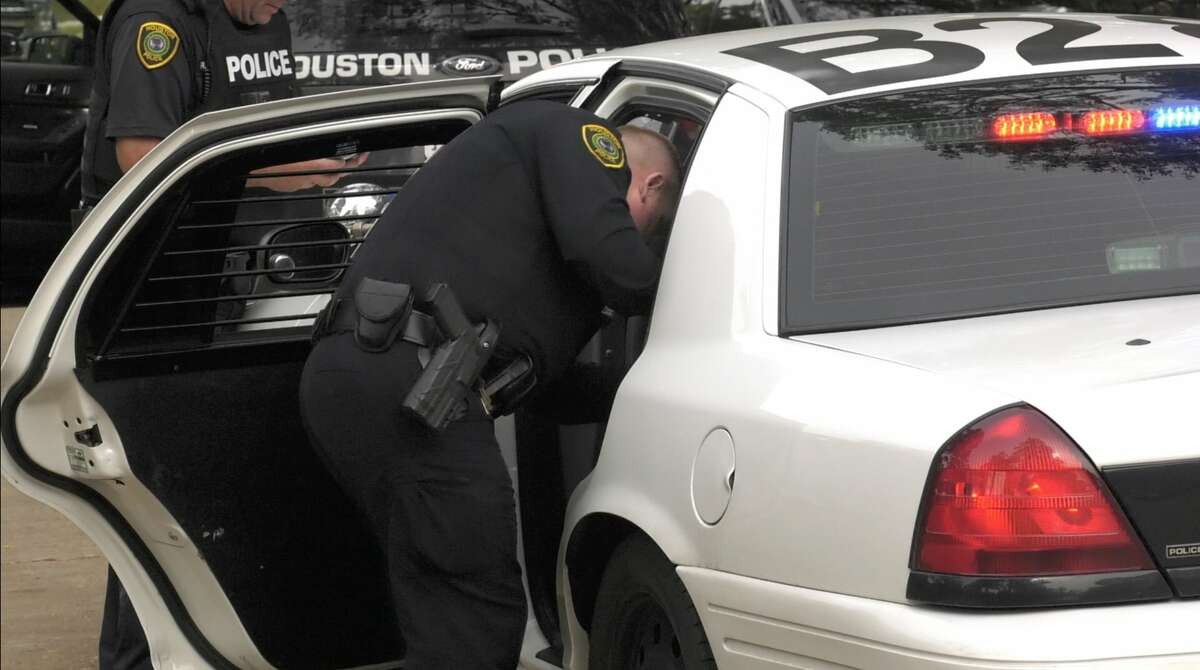 Houston police investigate the end of a police chase where a suspect who was driving without a seat belt led police on a 30-minute pursuit in west Houston on Wednesday, Nov. 13, 2019.