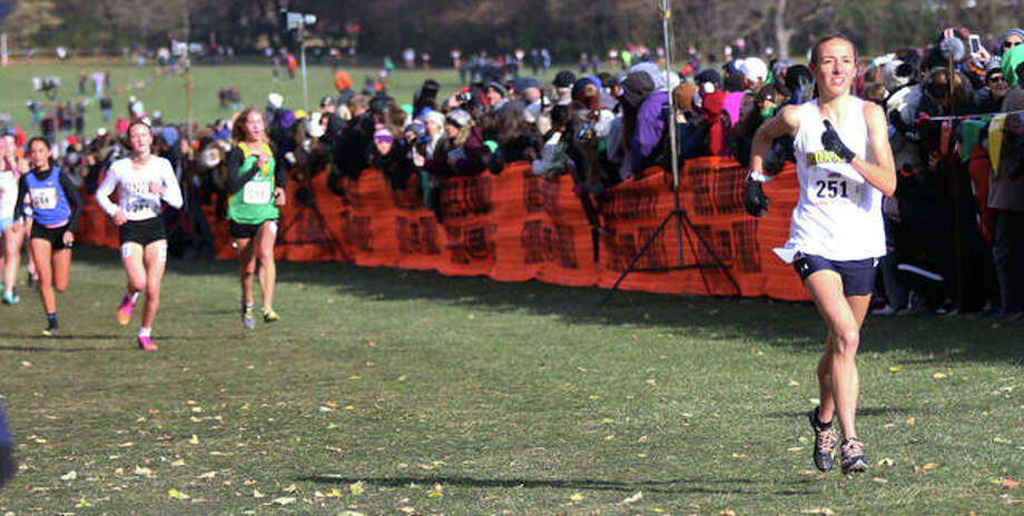 Roxana's Janelynn Wirth (right) approaches the finish in 39th place at the Class 1A girls race Saturday at Detweiller Park in Peoria. Photo: Greg Shashack / The Telegraph