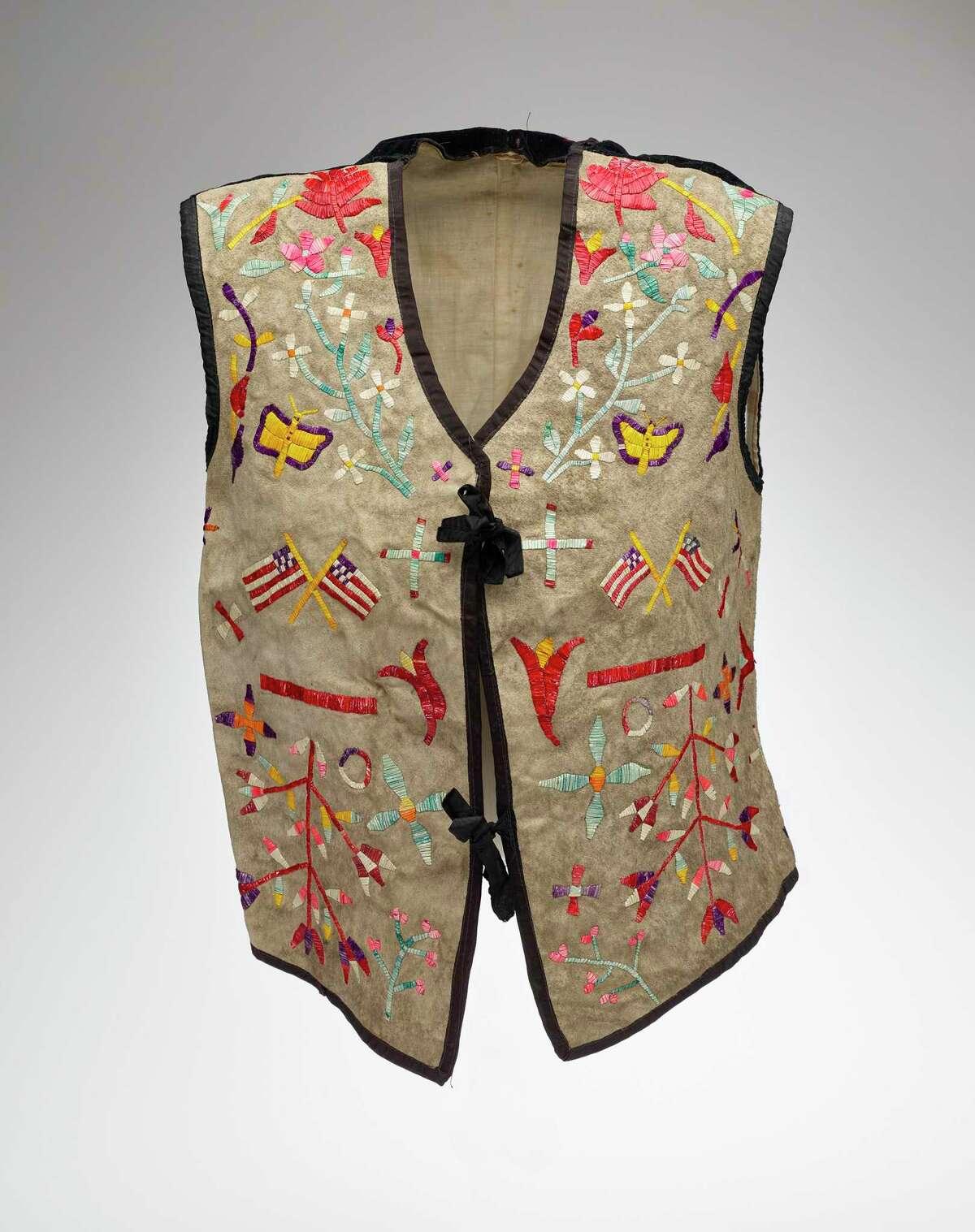A Dakota artist's vest, ca. late 19th century. Hide (possibly deer), porcupine quills, linen and velvet.