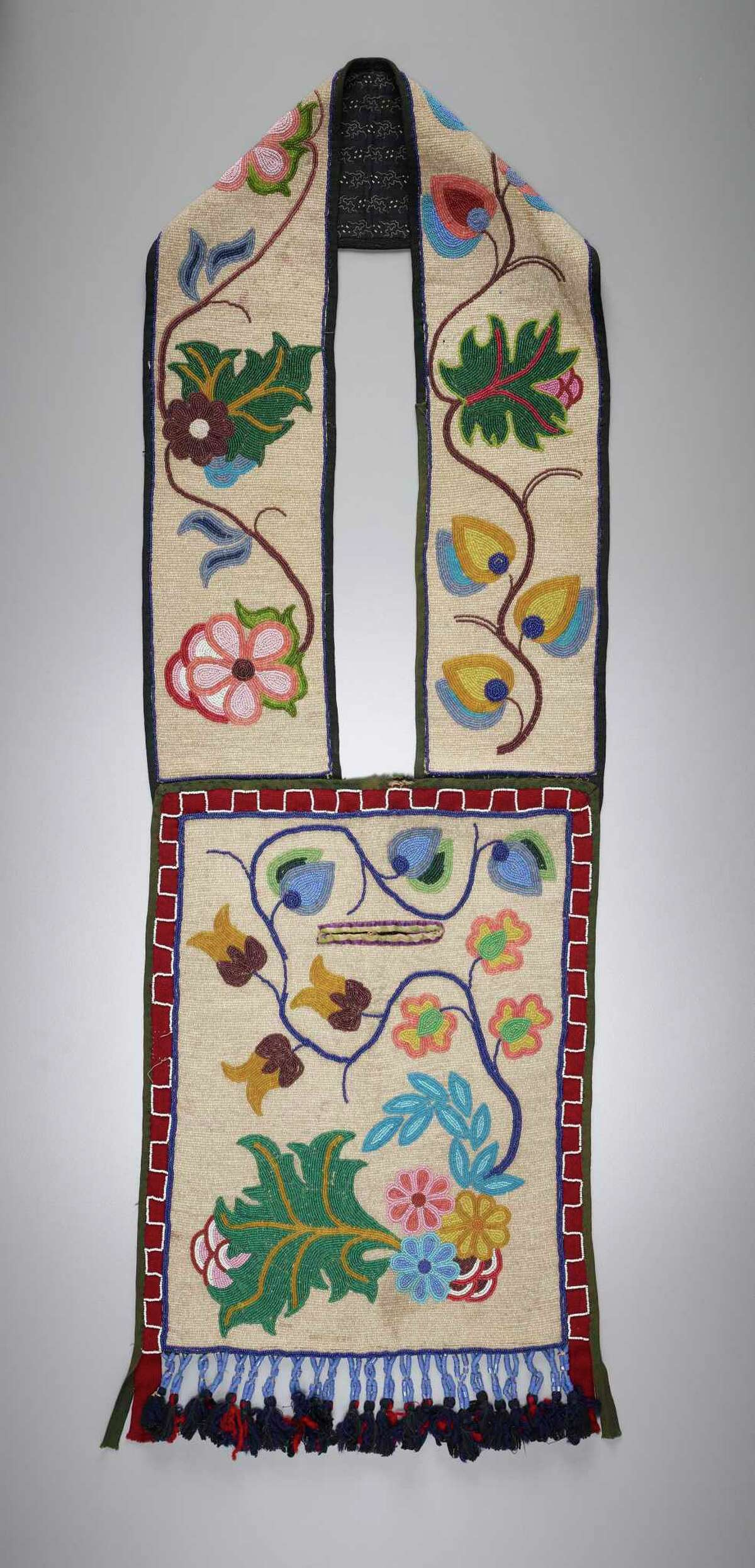 An Anishinaabe) artist's Aazhooningwa'on (Bandolier Bag), ca. early 20th century. Wool, glass beads, and cotton.