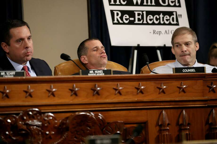 Ranking member of the House Intelligence Committee Devin Nunes (R-CA), minority counsel Steve Castor and Rep. Jim Jordan (R-OH) listen to opening statements. Photo: Drew Angerer, Getty Images