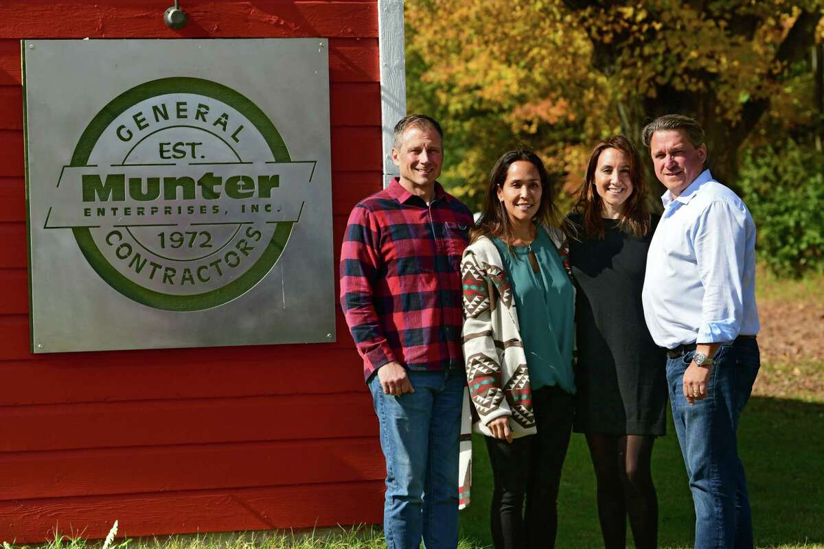 From left, John, Cindy, Lisa and Michael Munter stand in front of their sign at Munter Enterprises on Thursday, Oct. 10, 2019 in Middle Grove, N.Y. (Lori Van Buren/Times Union)