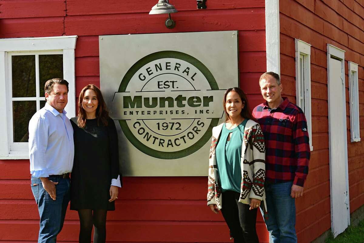From left, Michael, Lisa, Cindy and John Munter stand in front of their sign at Munter Enterprises on Thursday, Oct. 10, 2019 in Middle Grove, N.Y. (Lori Van Buren/Times Union)