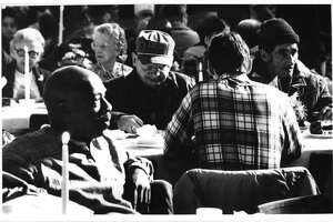 1st Presbyterian Church, Albany, New York - Project Equinox Dinner - some people wait for the dinner to begin. November 23, 1989 (Paul D. Kniskern, Sr./Times Union Archive)