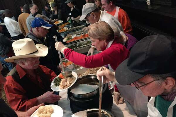 Volunteers serve the Equinox Thanksgiving dinner at First Presbyterian Church on State Street, Albany, on Nov. 24, 2016. (Cindy Schultz/Times Union)