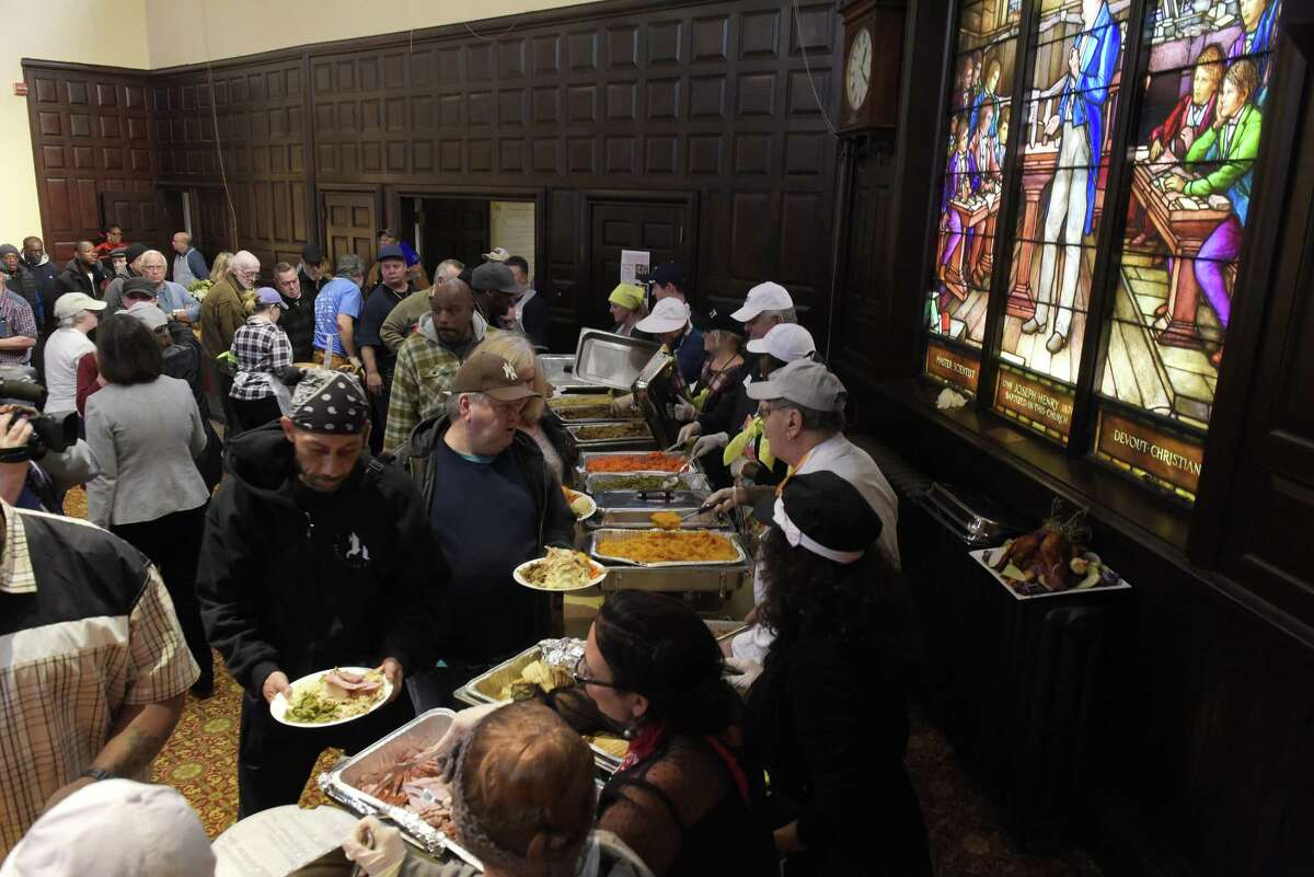 Volunteers serve food at the 48th Annual Equinox Thanksgiving Community Dinner on Thursday, Nov. 23, 2017, in Albany, N.Y. (Paul Buckowski / Times Union)