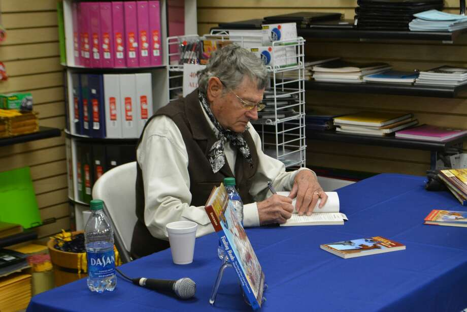 """Fans of all ages gathered at the Wayland Baptist University Bookstore Monday to meet John Erickson, author of the beloved """"Hank The Cowdog"""" book series on Monday. Photo: Ian Kirk/For The Herald"""