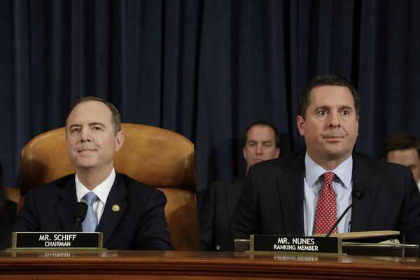 Rep. Adam Schiff, a Democrat from California and chairman of the House Intelligence Committee (left) and Rep. Devin Nunes, a Republican from California and ranking member of the House Intelligence Committee, wait for the start of the impeachment inquiry hearing in Washington on Nov. 13, 2019.