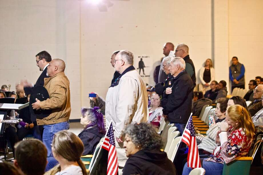 Veterans stand for their Armada during a celebration of veterans at Hale Center's Carr Middle School on Monday. Photo: Don Brown/For The Herald