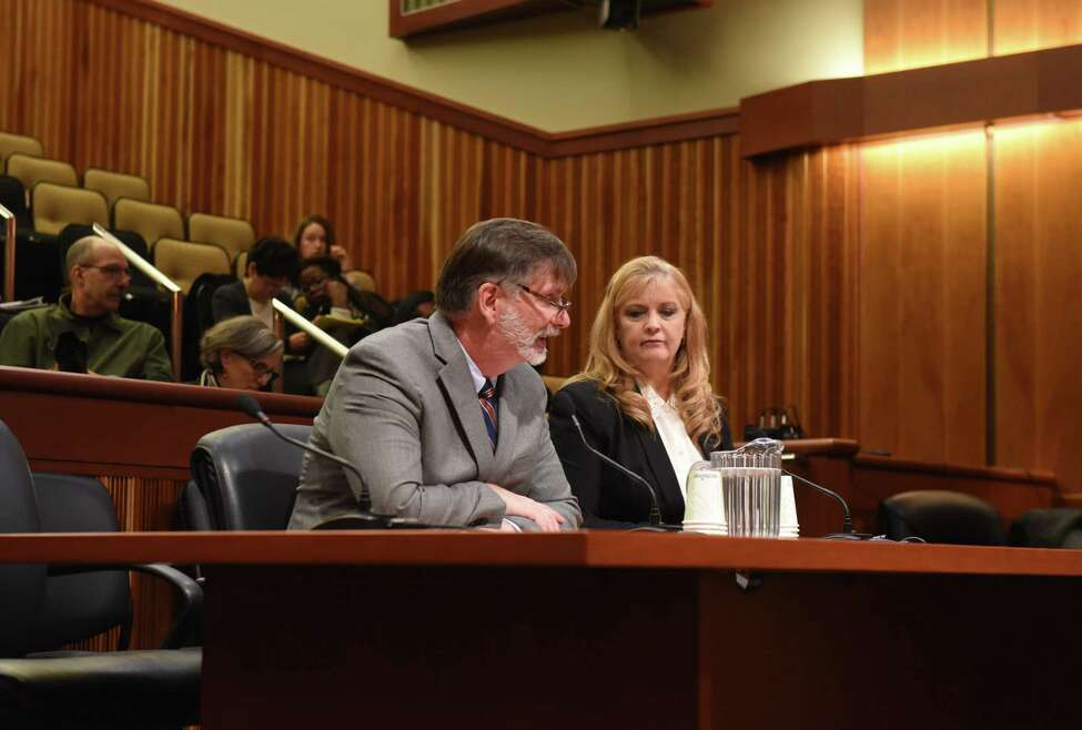 Robert Megna, senior vice chancellor and chief operating officer, State University of New York, left, and Karren Bee-Donohoe, associate vice chancellor, SUNY Office for Capital Facilities, right, testify during a public hearing on the environmental footprint of colleges and universities in New York State on Wednesday, Nov. 12, 2019, at the Legislative Office Building in Albany, N.Y. (Will Waldron/Times Union)