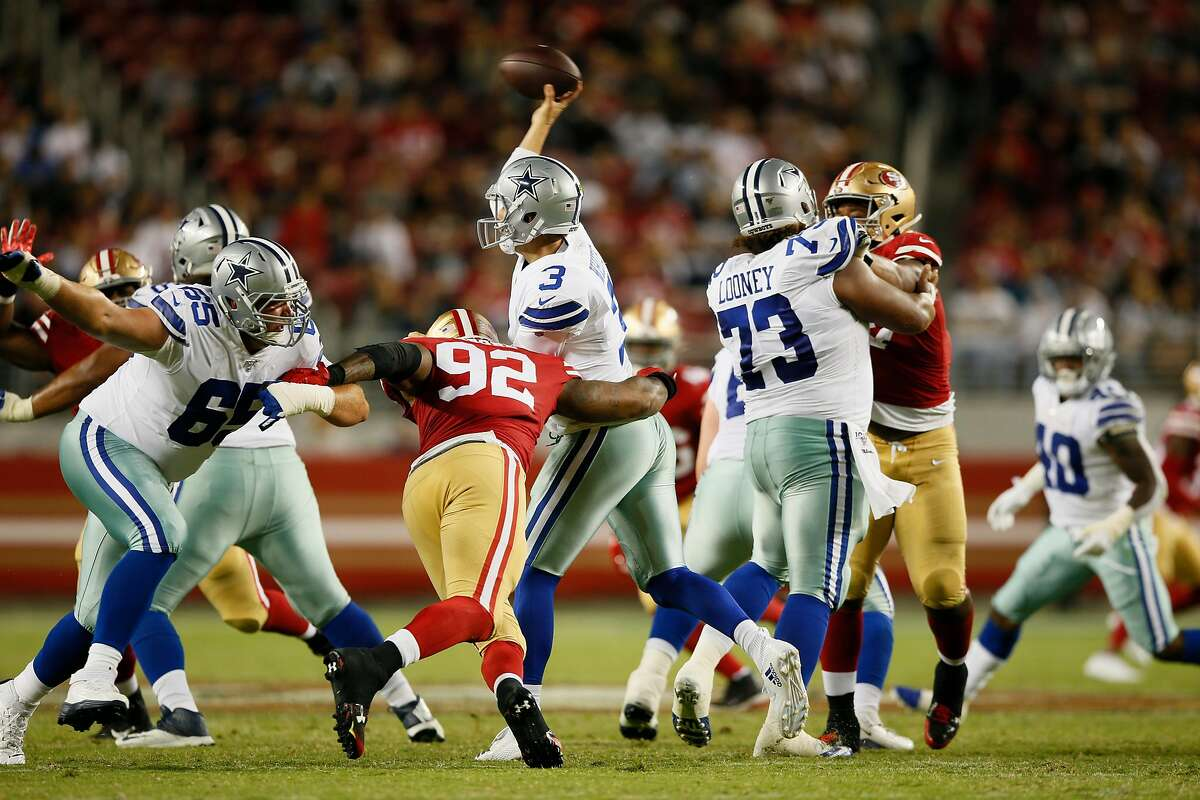 Dallas Cowboys quarterback Mike White (3) is hit as he throws against San Francisco 49ers Damontre Moore (92) during an NFL preseason game at Levi's Stadium on Saturday, Aug. 10, 2019, in Santa Clara, Calif.