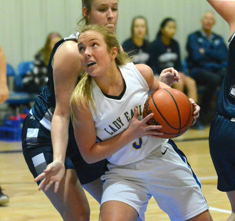 Plainview Christian Academy's Peyton Teeple ducks around Lubbock Southcrest Christian defender Mackenzie Garrison for the layup during their girls basketball game on Tuesday at PCA. Photo: Nathan Giese/Planview Herald