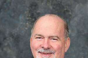Roger Bemis retired from his position as Kelly Catholic High School Principal.