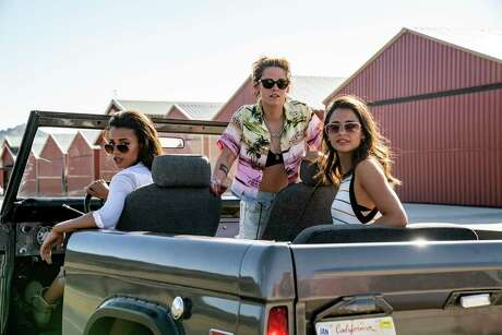 """This image released by Sony Pictures shows, from left, Ella Balinska, Kristen Stewart and Naomi Scott in """"Charlie's Angels,"""" in theaters on Nov. 15. (Merie Weismiller Wallace/Sony Pictures via AP)"""