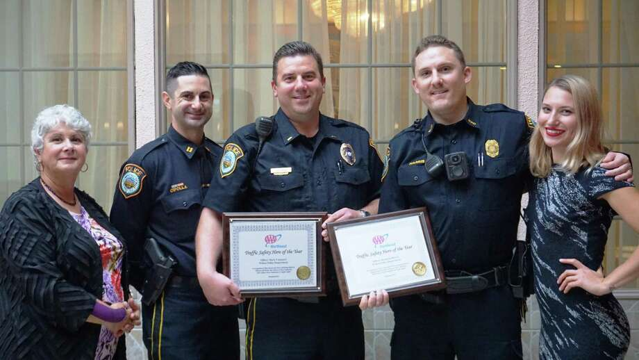 AAA's Public Affairs Manager Fran Mayko, left, presents awards to, from left, Capt. Robert Cipolla, Lt. Dave Hartman, and Officer Brandon Harris. At right is AAA Public Affairs' Adelle Zocher. Officer Mark Canepari is missing from photo. Photo: Contributed Photo / AAA Northeast / Wilton Bulletin Contributed