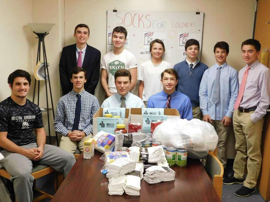 Members of Socks for Soldiers are, standing, from left, Roen Crameri, James Vollmer, Sam Gioffre, Eli Ackerman, Tyler Casey and Ryan Leung. Sitting are Dom Polito, Connor Burke, Jake Zeyher and Jack Savarese. Photo: Contributed Photo / Socks For Soldiers / Wilton Bulletin Contributed