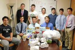 Members of Socks for Soldiers are, standing, from left, Roen Crameri, James Vollmer, Sam Gioffre, Eli Ackerman, Tyler Casey and Ryan Leung. Sitting are Dom Polito, Connor Burke, Jake Zeyher and Jack Savarese.