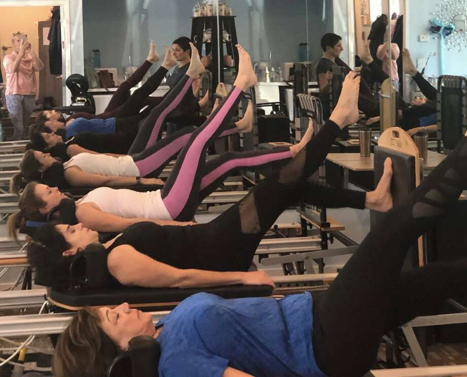 Women participate in a Round Robin Workout on Nov. 3 to raise money for The Hearing Aid Project at The Pilates Advantage in Wilton. Photo: Contributed Photo / The Pilates Advantage / Wilton Bulletin Contributed