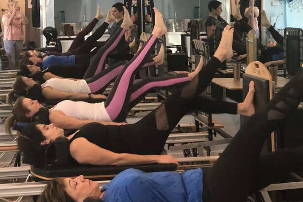 Women participate in a Round Robin Workout on Nov. 3 to raise money for The Hearing Aid Project at The Pilates Advantage in Wilton.