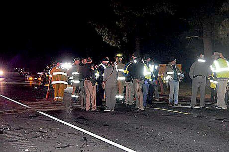 Emergency personnel work the scene of a multi-vehicle crash in which two children were seriously injured. The incident occured Tuesday night, Nov. 12, on TX 105 east of Sour Lake. Photo provided by Eric Williams