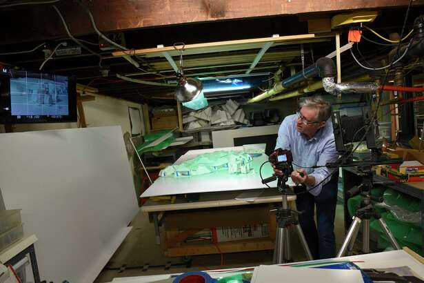 Artist Ken Ragsdale sets up a shot in his basement studio at his home on Thursday, Nov. 7, 2019 in Albany, N.Y. (Lori Van Buren/Times Union)