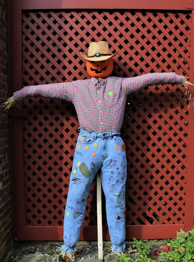 Jason Gong, CeCe Duques, and Andrew Duques, creators of Mr. Pumpkin Head, won the People's Choice Vote on Facebook in Keeler Tavern Museum & History Center's seventh annual Scarecrow Contest. Photo: Contributed Photo