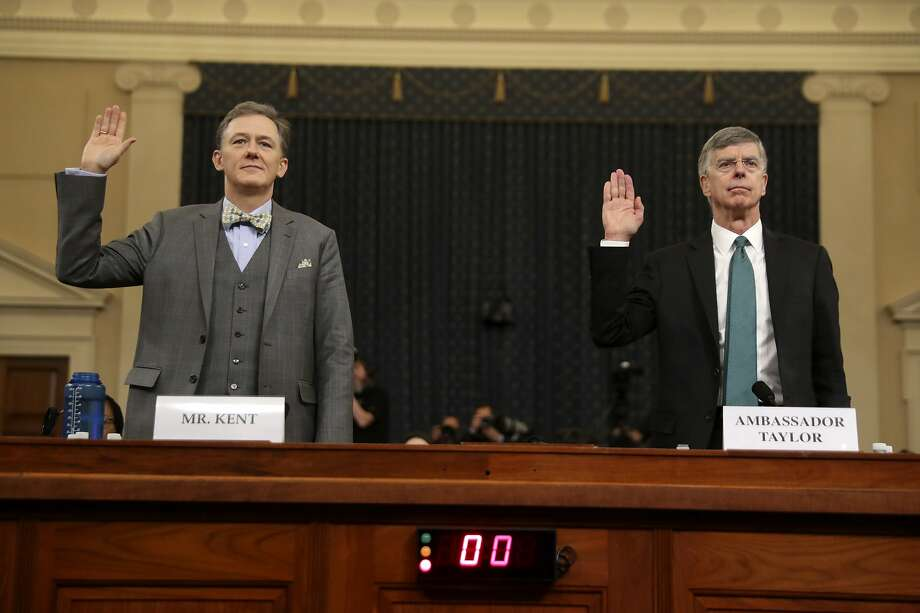 Career Foreign Service officer George Kent and top U.S. diplomat in Ukraine William Taylor, right, are sworn in to testify during the first public impeachment hearing of the House Intelligence Committee on Capitol Hill, Wednesday Nov. 13, 2019 in Washington.(AP Photo/Andrew Harnik) Photo: Andrew Harnik, Associated Press
