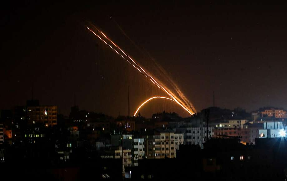 Rockets fired from the Gaza Strip streak toward Israel Wednesday night. Israel responded with air strikes in clashes sparked by the killing of a Palestinian leader and his wife this week. Photo: Anas Baba / AFP Via Getty Images