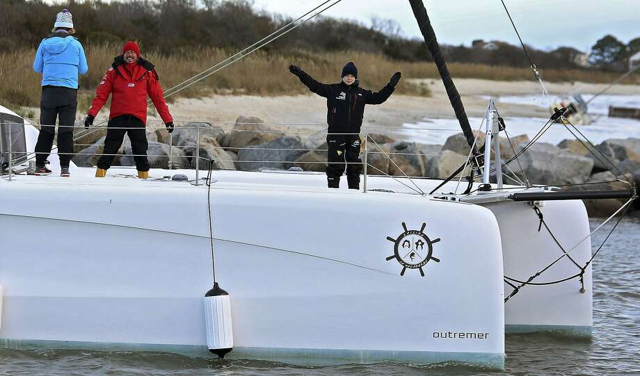 Swedish teen climate activist Greta Thunberg waves from an Australian couple's 48-foot catamaran named La Vagabonde as it departs for Europe from Salt Ponds in Hampton, Va. Photo: Rob Ostermaier / Virginian-Pilot