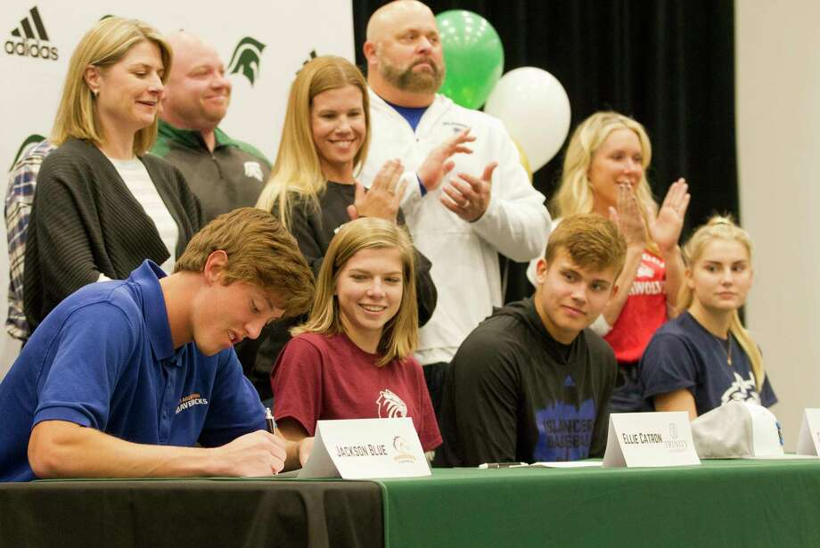 PHOTOS: 2019 Early signing period  Jackson Blue signed to play baseball for UT-Arlington as Ellie Catron, Caden Queck and Caleigh Winbourn look on during a National Signing Day ceremony at The Woodlands Christian Academy, Wedensday, Nov. 13, 2019, in The Woodlands.  >>>See Houston-area athletes make their commitments official during the early signing period ...  Photo: Jason Fochtman, Staff Photographer / Houston Chronicle