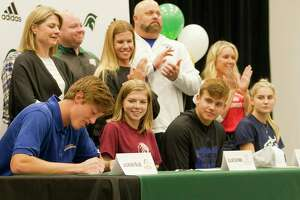 Jackson Blue signed to play baseball for UT-Arlington as Ellie Catron, Caden Queck and Caleigh Winbourn look on during a National Signing Day ceremony at The Woodlands Christian Academy, Wedensday, Nov. 13, 2019, in The Woodlands.