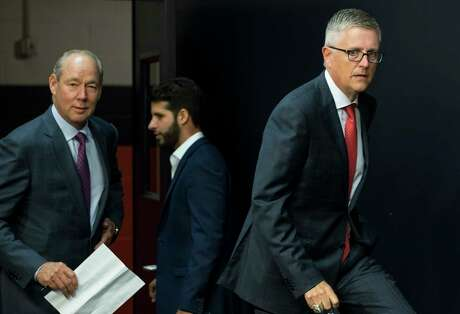 Houston Astros' Jeff Luhnow, followed by owner Jim Crane, arrive to a news conference announcing that he has been named President of Baseball Operatoions and General Manager at Minute Maid Park on Monday, June 18, 2018, in Houston. Luhnow also was given a contract extension through the 2023 season.