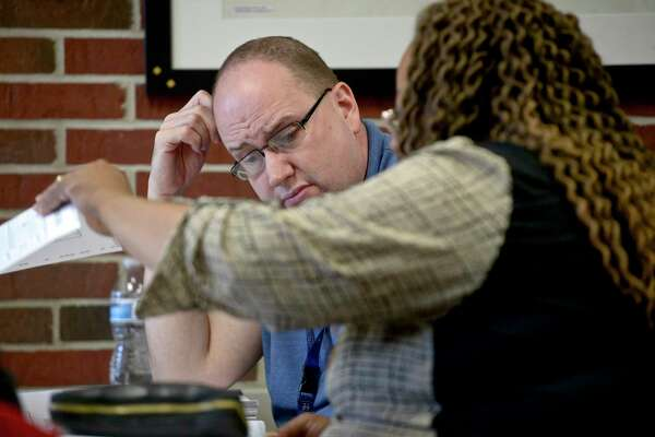 Bob Zarbock, left, and Angela Perkins look at ballots during a recount of last weeks election. Wednesday, November 13, 2019, in Danbury, Conn.
